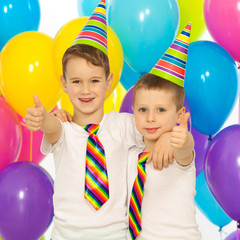 Two little boys at birthday party