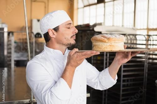 Papiers peints Table preparee Baker smelling a freshly baked loaf