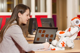 Child playing and learning with robot - 78359032