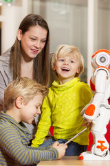 Children playing and learning with robot