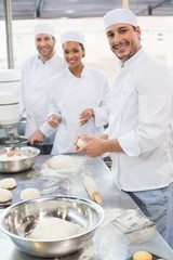 Team of bakers working at counter