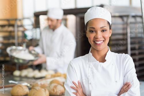 Pretty baker smiling at camera - 78359260