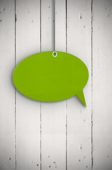 Composite image of speech bubble tag hanging
