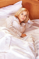 Young  blonde woman in the bed
