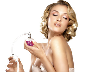Young woman applying perfume on her neck space for text