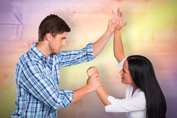 Composite image of aggressive man overpowering his girlfriend