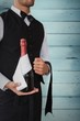 Composite image of waiter holding magnum of champagne