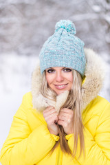 Happy young smiling woman at winter outdoor.
