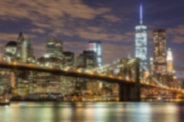 Brooklyn Bridge and Downtown Skyscrapers in New York. Blurred Ba