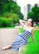 Young beautiful fashionable woman wearing striped dress