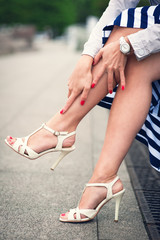 Legs of woman with high heels outdoor