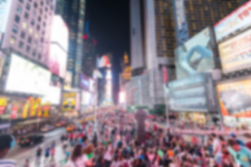 Times Square crowded of tourists at night. Blurred Background.