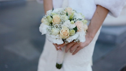 Young woman hold bouquet in her hands