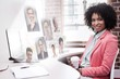 Composite image of happy casual businesswoman sitting at desk