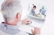 Grey haired man using laptop