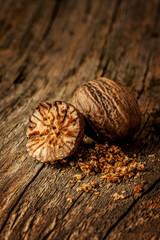 Nutmeg spice close up (macro) on vintage wood