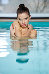 Portrait of a woman relaxing in swimming pool
