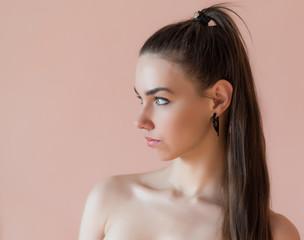 Girl in profile. Portrait of a beautiful brunette.