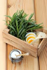 Eggs and fresh tarragon on pita bread