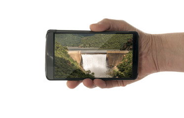 female hand with mobile phone waterfall