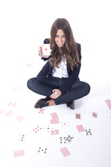 Happy attractive girl holding poker cards