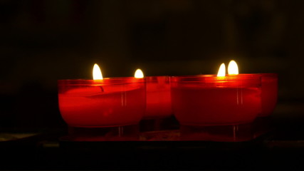 Little red candles in a church