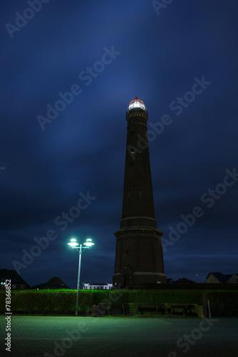 canvas print picture Leuchtturm mit Leuchtfeuer