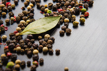 laurel leaves a mix four pepper on wooden table