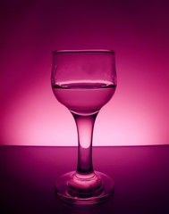 glass on a colored background with a liquid