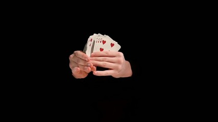 Magician makes playing card show concept on black background