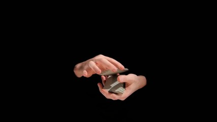 Magic trick with cards on black background, slow motion