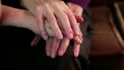 Old couple playing with hands