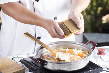 Chef putting Japanese curry paste for cooking