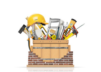 Box with construction tools and brick wall