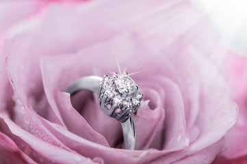 ring with diamonds  inside rose petals
