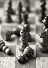 Wooden chess pieces on a chessboard