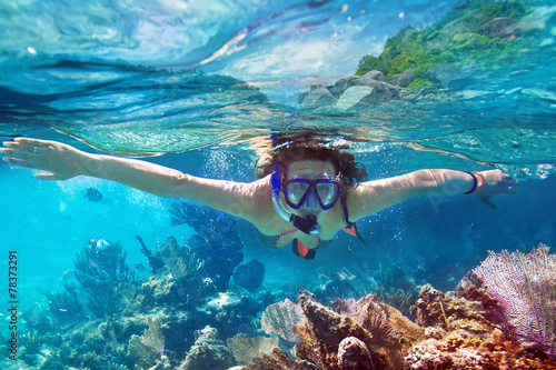 Young women at snorkeling in the tropical water - 78373291