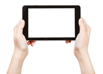 hands holds tablet-pc with cut out screen