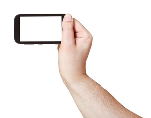 male hand holds smart phone with cut out screen