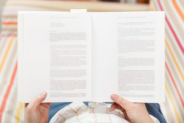 man read book with blurred text