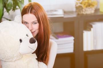 girl hugs the teddy bear