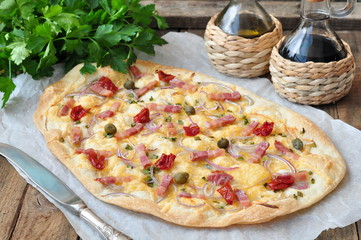 French traditional dish tarte Flambee with onion and ham