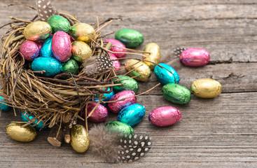 Chocolate easter eggs in nest. Festive still life