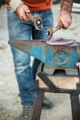 Blacksmith forging a horseshoe