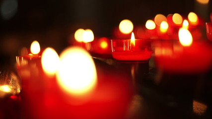 Red votive candles close up.