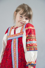 Little girl in a cunning Russian folk costume..