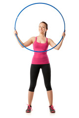 Closeup of young woman standing with hula hoop up