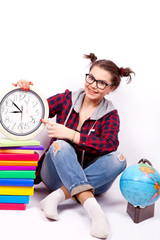 Student at the clock, books and globe on a white background