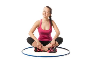 beauty girl sitting with hula hoop on floor
