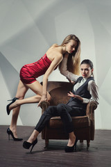 Beautiful lesbian flirting couple in the chair.